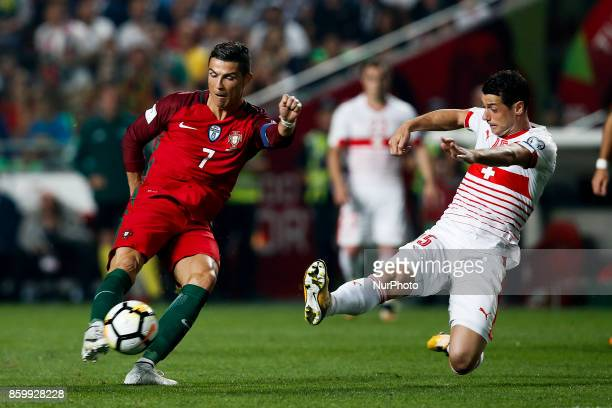 Portugal's forward Cristiano Ronaldo vies for the ball with Switzerland's midfielder Blerim Dzemaili during the FIFA World Cup WC 2018 football...