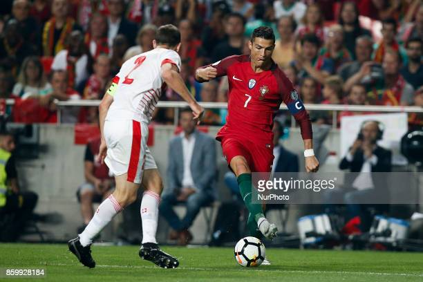 Portugal's forward Cristiano Ronaldo vies for the ball with Switzerland's defender Stephan Lichtsteiner during the FIFA World Cup WC 2018 football...