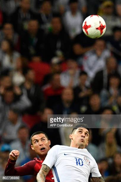 Portugal's forward Cristiano Ronaldo vies with Chile's midfielder Pablo Hernandez during the 2017 Confederations Cup semifinal football match between...