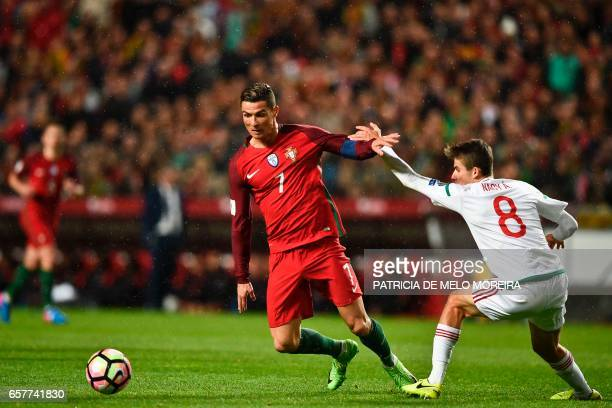 Portugal's forward Cristiano Ronaldo vies with Hungary's midfielder Adam Nagy during the WC 2018 group B football qualifing match Portugal vs Hungary...