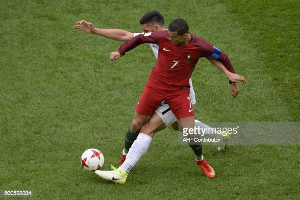 Portugal's forward Cristiano Ronaldo vies with New Zealand's defender Michael Boxall during the 2017 Confederations Cup group A football match...