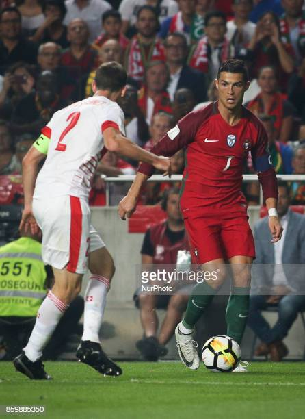 Portugal's forward Cristiano Ronaldo vies with Switzerland's defender Stephan Lichtsteiner during the FIFA 18 World Cup Qualifier match between...