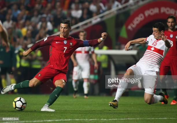 Portugal's forward Cristiano Ronaldo vies with Switzerland's midfielder Blerim Dzemaili during the FIFA 2018 World Cup Qualifier match between...