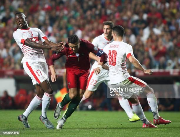 Portugal's forward Cristiano Ronaldo vies with Switzerland's midfielder Granit Xhaka and Switzerland's midfielder Denis Zakaria during the FIFA 2018...