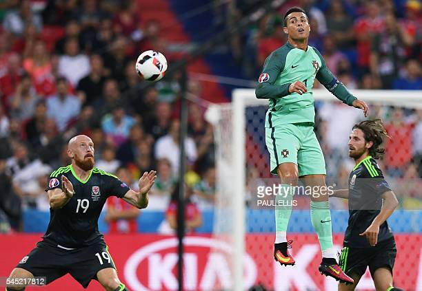 Portugal's forward Cristiano Ronaldo vies with Wales' defender James Collins during the Euro 2016 semifinal football match between Portugal and Wales...