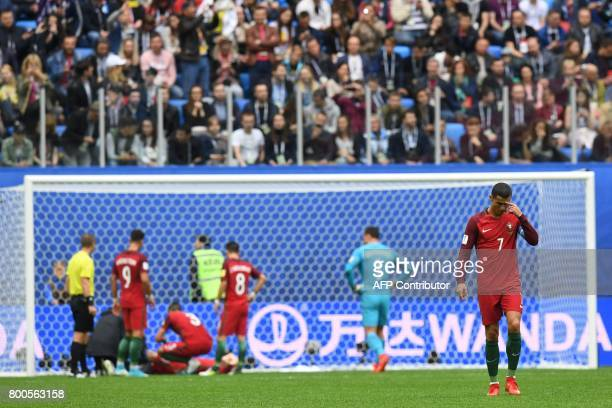 Portugal's forward Cristiano Ronaldo walks on the pitch after Portugal's midfielder Bernardo Silva scored a goal during the 2017 Confederations Cup...