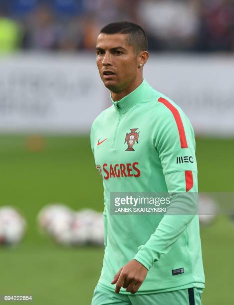 Portugal's forward Cristiano Ronaldo walks on the pitch ahead the FIFA World Cup 2018 qualification football match between Latvia and Portugal in...