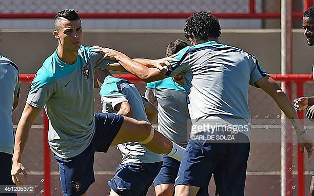 Portugal's forward Cristiano Ronaldo warms up during a training session in Brasilia on June 25 on the eve of the 2014 FIFA World Cup Group G football...