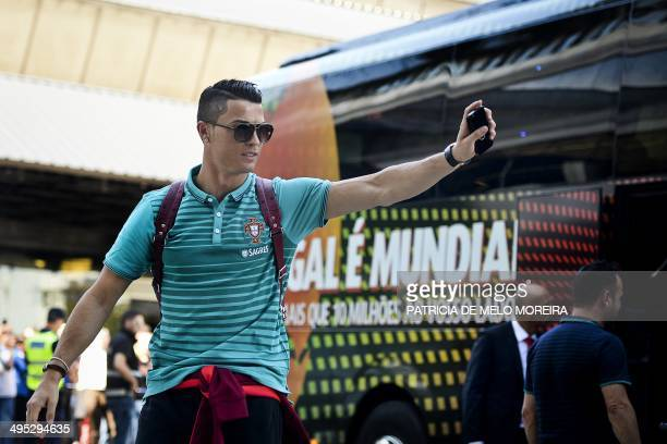 Portugal's forward Cristiano Ronaldo waves on arrival to the airport in Lisbon on June 2 2014 prior to the departure of the Portuguese National team...