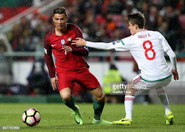 Portugal's forward Cristiano Ronaldo with HungaryÕs midfielder Adam Nagy in action during the FIFA 2018 World Cup Qualifier match between Portugal...