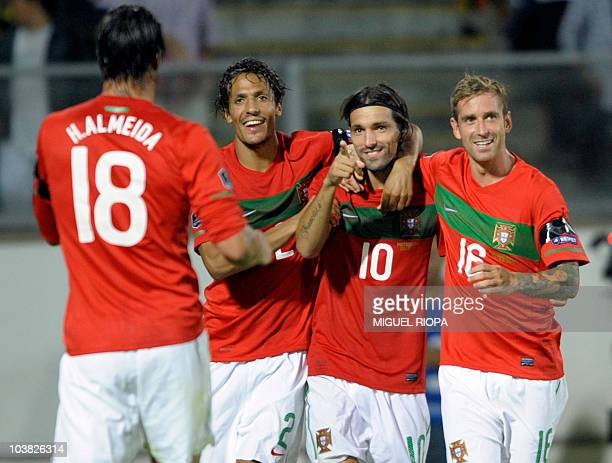 Portugal´s forward Danny Gomes celebrates with teammates after scoring against Cyprus during their Euro 2012 qualifying group H football match at at...