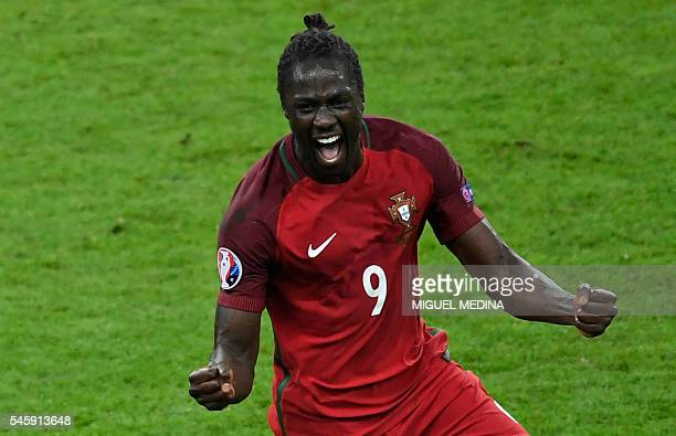 TOPSHOT Portugal's forward Eder celebrates after scoring a goal during the Euro 2016 final football match between Portugal and France at the Stade de...