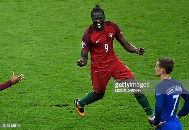 Portugal's forward Eder celebrates after scoring a goal next to France's forward Antoine Griezmann during the Euro 2016 final football match between...