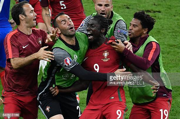 TOPSHOT Portugal's forward Eder celebrates after scoring a goal with team mates during the Euro 2016 final football match between Portugal and France...
