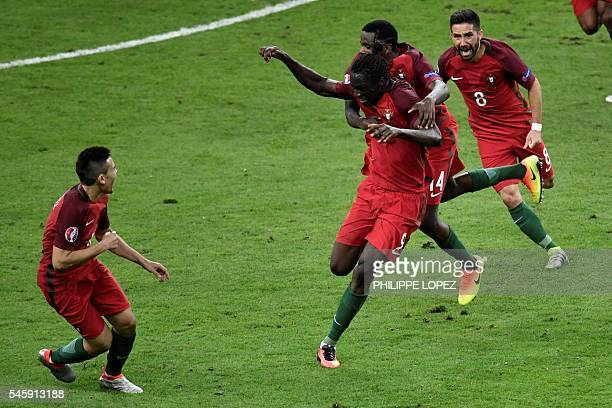 Portugal's forward Eder celebrates after scoring a goal with team mates during the Euro 2016 final football match between Portugal and France at the...
