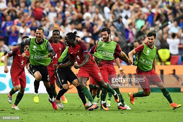 TOPSHOT Portugal's forward Eder celebrates after scoring the first goal during the Euro 2016 final football match between France and Portugal at the...