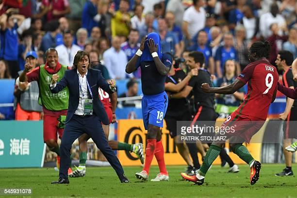 TOPSHOT Portugal's forward Eder celebrates next to France's midfielder Moussa Sissoko after he scored during the Euro 2016 final football match...