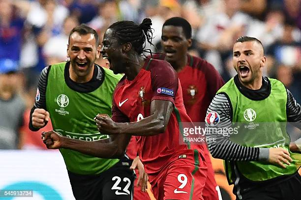 Portugal's forward Eder celebrates the team's first goal during the Euro 2016 final football match between France and Portugal at the Stade de France...