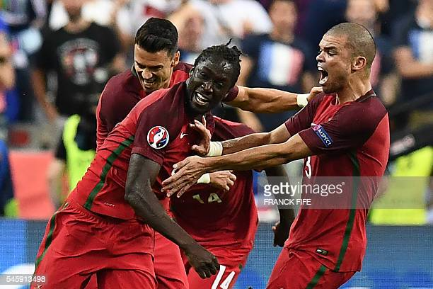 Portugal's forward Eder celebrates with Portugal's defender Pepe the team's first goal during the Euro 2016 final football match between France and...