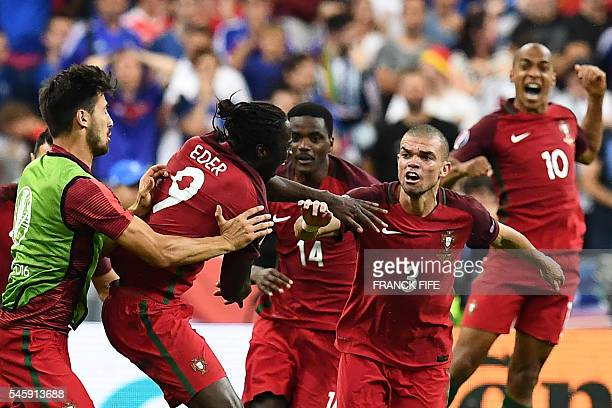 Portugal's forward Eder celebrates with Portugal's midfielder William Carvalho Portugal's defender Pepe and Portugal's midfielder Joao Mario the...