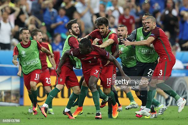 Portugal's forward Eder celebrates with teammates after scoring a goal during the Euro 2016 final football match between Portugal and France at the...