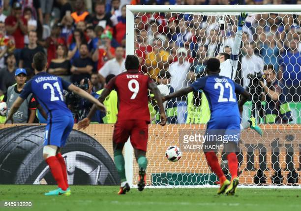 TOPSHOT Portugal's forward Eder fails to score past France's goalkeeper Hugo Lloris during the Euro 2016 final football match between Portugal and...