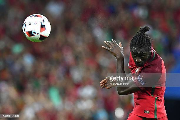 TOPSHOT Portugal's forward Eder heads the ball during the Euro 2016 final football match between France and Portugal at the Stade de France in...