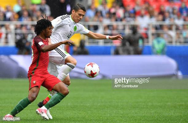 TOPSHOT Portugal's forward Gelson Martins challenges Mexico's defender Hector Moreno during the 2017 FIFA Confederations Cup third place football...