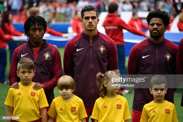 Portugal's forward Gelson Martins Portugal's forward Andre Silva and Portugal's defender Eliseu listen to the national anthems ahead of the 2017 FIFA...
