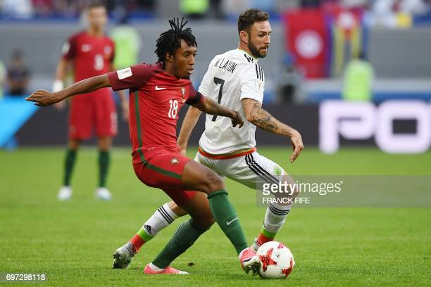 Portugal's forward Gelson Martins vies with Mexico's midfielder Miguel Layun during the 2017 Confederations Cup group A football match between...