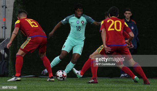 Portugal's forward Gelson Martins vies with Moises San Nicolas and Max Llovera during the FIFA World Cup 2018 football qualifier between Andorra and...