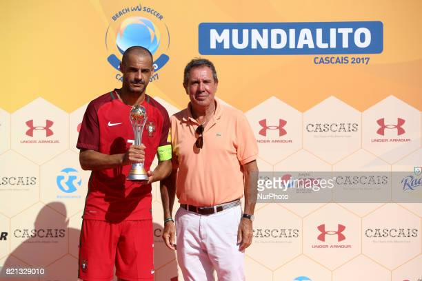 Portugal's forward Madjer raises the 2nd place trophy after the Beach Soccer Mundialito 2017 match between Portugal and Brazil at the Carcavelos...