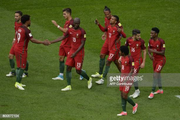Portugal's forward Nani celebrates with Portugal's defender Bruno Alves and teammates after scoring a goal during the 2017 Confederations Cup group A...