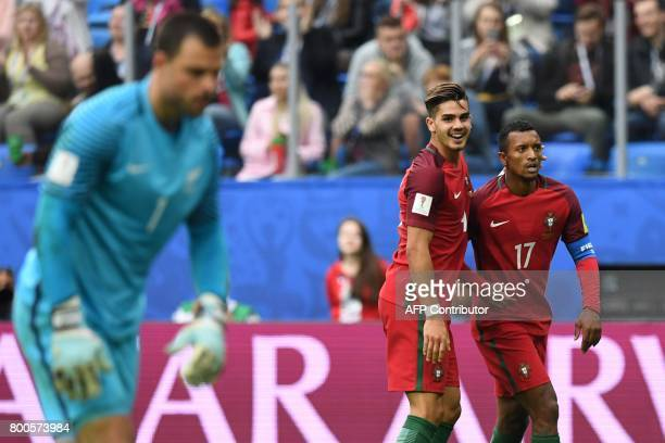 Portugal's forward Nani celebrates with Portugal's forward Andre Silva after scoring the team's fourth goal during the 2017 Confederations Cup group...