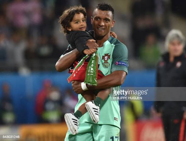 Portugal's forward Nani holds with his son Lucas at the end of the Euro 2016 round of sixteen football match Croatia vs Portugal on June 25 2016 at...