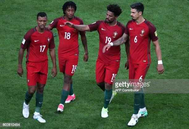Portugal's forward Nani Portugal's forward Gelson Martins Portugal's defender Eliseu and Portugal's defender Jose Fonte leave bing defeated in the...