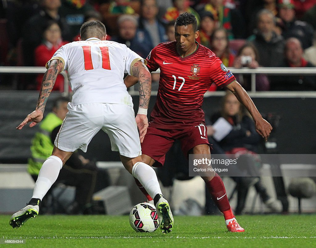 Portugal's forward <a gi-track='captionPersonalityLinkClicked' href=/galleries/search?phrase=Nani+-+Soccer+Player&family=editorial&specificpeople=11510994 ng-click='$event.stopPropagation()'>Nani</a> tries to pass trough Serbian'´s defender <a gi-track='captionPersonalityLinkClicked' href=/galleries/search?phrase=Aleksandar+Kolarov&family=editorial&specificpeople=4329824 ng-click='$event.stopPropagation()'>Aleksandar Kolarov</a> during the UEFA Euro 2016 Qualifier between Portugal and Serbia at Estadio da Luz on March 29, 2015 in Lisbon, Portugal.