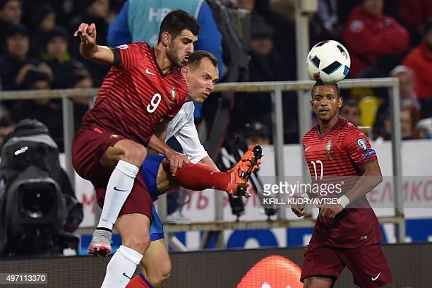 Portugal's forward Nelson Oliveira and Portugal's forward Nani vie for the ball with Russia's defender Sergei Ignashevich during the friendly...