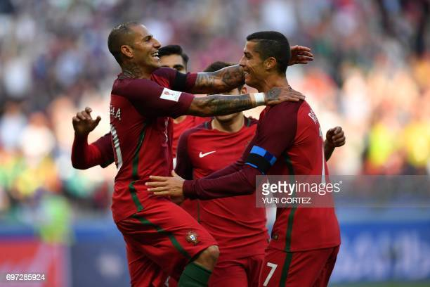 Portugal's forward Ricardo Quaresma and Portugal's forward Cristiano Ronaldo celebrate scoring the first goal in the nets of Mexico's goalkeeper...
