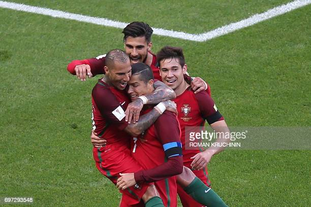 Portugal's forward Ricardo Quaresma and Portugal's forward Cristiano Ronaldo celebrate after the first goal during the 2017 Confederations Cup group...