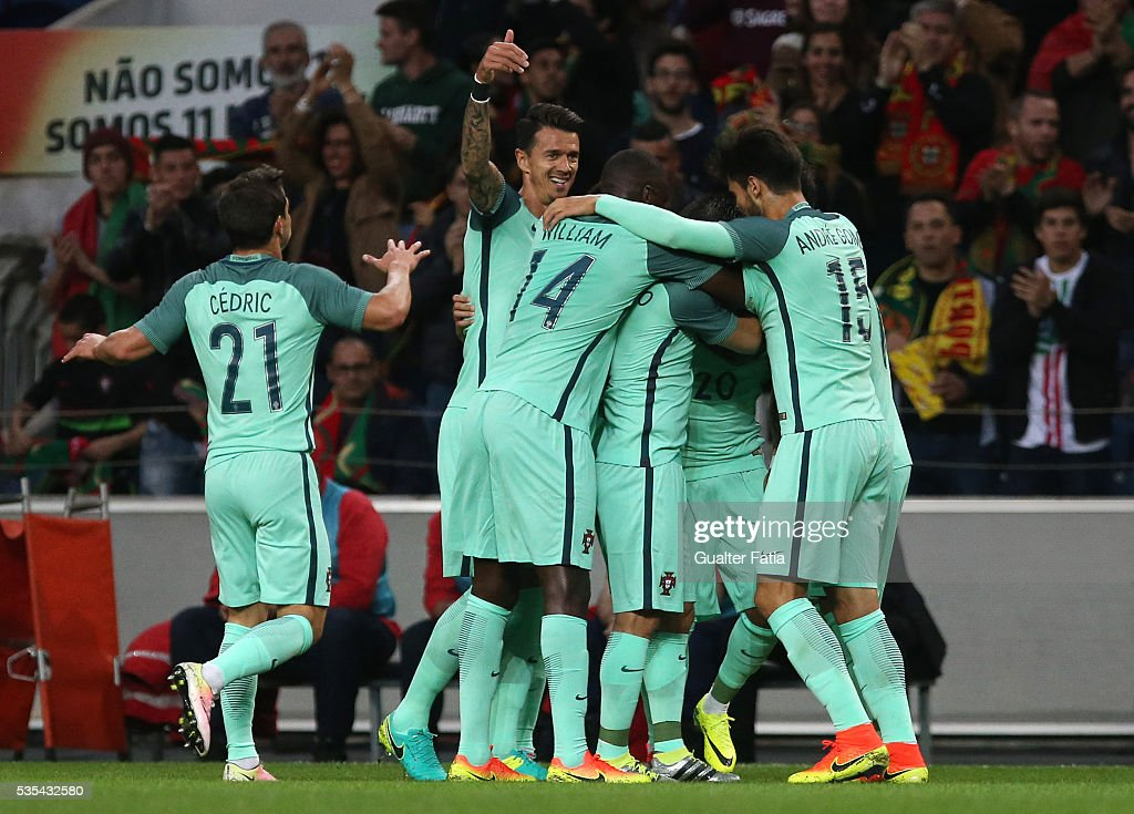 Portugal's forward <a gi-track='captionPersonalityLinkClicked' href=/galleries/search?phrase=Ricardo+Quaresma&family=editorial&specificpeople=605412 ng-click='$event.stopPropagation()'>Ricardo Quaresma</a> celebrates with team-mates after scoring a goal during the International Friendly match between Portugal and Norway at Estadio do Dragao on May 29, 2016 in Porto, Portugal.