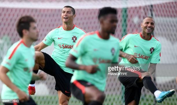 Portugal's foward Cristiano Ronaldo and Ricardo Quaresma smile during a training session ahead of the Russia 2017 Confederation Cup football...
