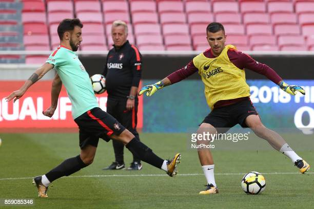 Portugals goalkeeper Anthony Lopes and Portugals midfielder Bruno Fernandes in action during National Team Training session before the match between...