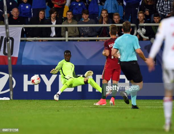 Portugal's goalkeeper Bruno Varela fails to save the ball during the UEFA U21 European Championship Group B football match Portugal v Spain on June...