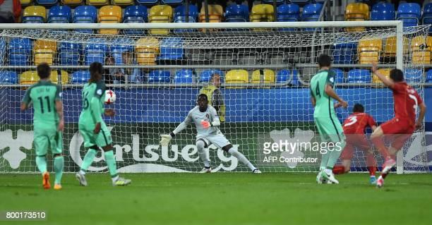 Portugal's goalkeeper Bruno Varela fails to save the shot of Macedonia's midfielder Enis Bardi during the UEFA U21 European Championship Group B...