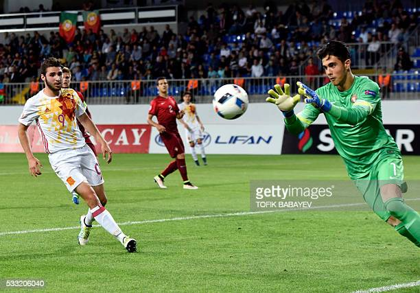 Portugal's goalkeeper Diogo Costa vies for a ball with Spain's forward Abel Ruiz during the 2016 UEFA European Under17 Championship final football...