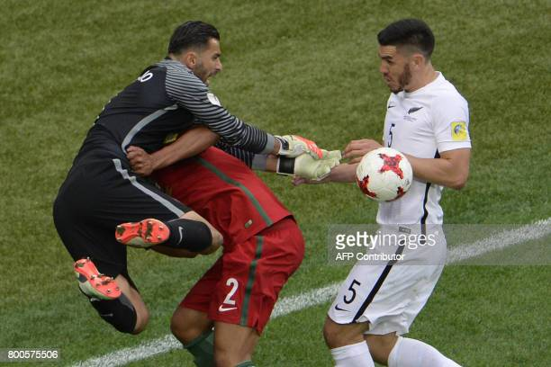 Portugal's goalkeeper Rui Patricio and Portugal's defender Bruno Alves vie with New Zealand's defender Michael Boxall during the 2017 Confederations...