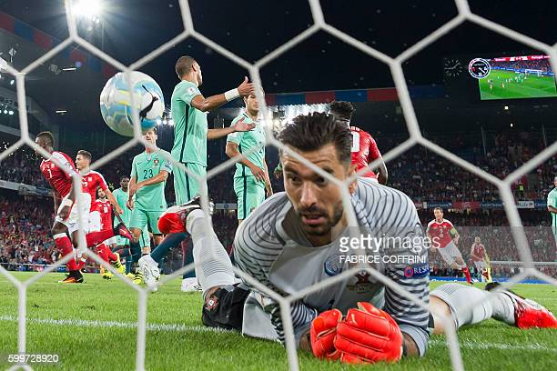 TOPSHOT Portugal's goalkeeper Rui Patricio concedes a goal during the FIFA World Cup WC 2018 football qualifier between Switzerland and Portugal at...
