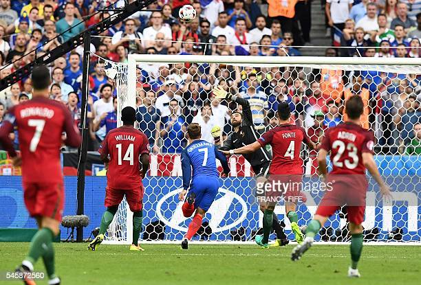 TOPSHOT Portugal's goalkeeper Rui Patricio jumps for the ball during the Euro 2016 final football match between France and Portugal at the Stade de...