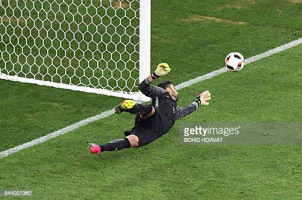 Portugal's goalkeeper Rui Patricio stops a penalty shot by Poland's midfielder Jakub Blaszczykowski during the Euro 2016 quarterfinal football match...
